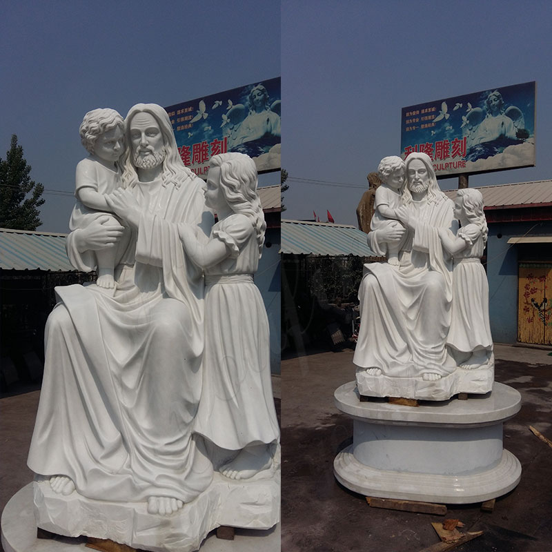 Jesus-holding-children-sculpture