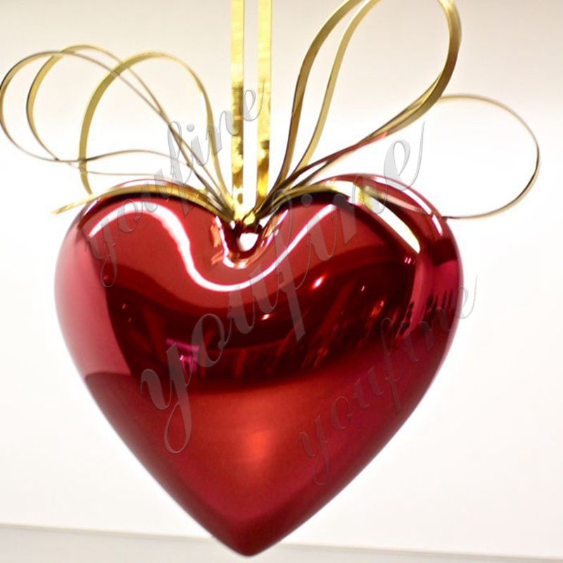 Large abstract metal sculpture Jeff Koons hanging heart Featured Image
