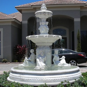 Large outdoor white marble water fountain with column decoration